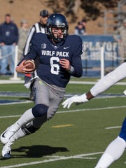 Nevada quarterback Ty Gangi (6) likes to run.