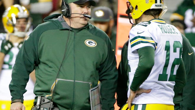 Green Bay Packers quarterback Aaron Rodgers (12) talks with head coach Mike McCarthy on the sidelines at Fedex Field during the game against the Washington Redskins  January 10, 2016.