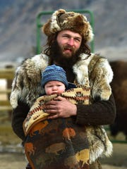 Buffalo Bridge volunteer Alex and his son Baby Boy walk to the kitchen tent in the Buffalo Bridge Project's camp north of Gardiner and close to one of the prime bison hunting areas.