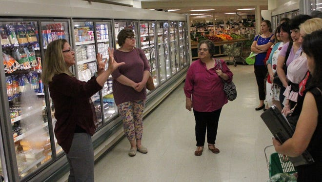 Diane Labenski (center) took a Healthy Shopping Tour at Adams Fairacre Farms in Poughkeepsie with BetterU Challengers led by nutritionist, Jodi Darling.