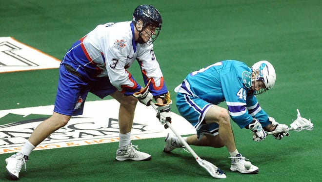 Jordan Hall, right, gets bowled over by Toronto's Brock Sorensen during the Knighthawks' season-opening, 13-12 home loss to the Rock. The teams play Friday night in Toronto.