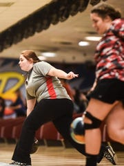 Elgin's Hallie Hall launches her ball down the lane during the Girls Division II State Bowling Championships held at Waynes Webb's Columbus Bowl on Saturday.