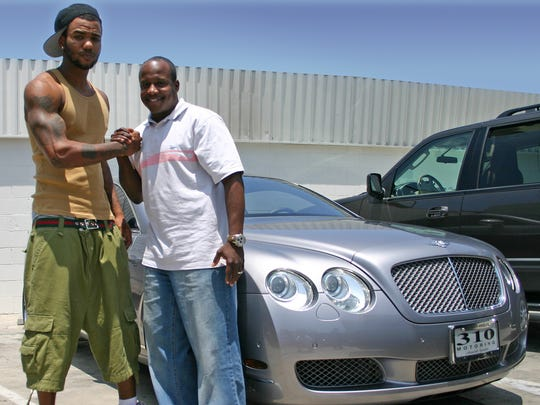 The rapper Game, left, with Marc Laidler, founder of the auto customizing service 310 Motoring.  Laidler has an array of businesses, including one in which Shante Broadus, Snoop Dogg's wife, is an officer.