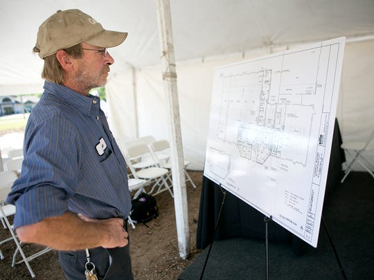Trailer mechanic Ron Goodwin looks at the blueprints for the new Plainfield Trucking facility after the ground breaking ceremony, Wednesday, Sept. 9, 2015.
