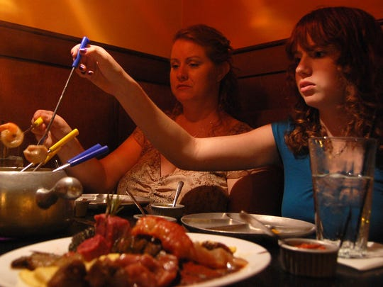 Robin Yearley, left, and her daughter Talor King, 15, eat fondue at The Melting Pot in Fort Collins on July 23, 2008.