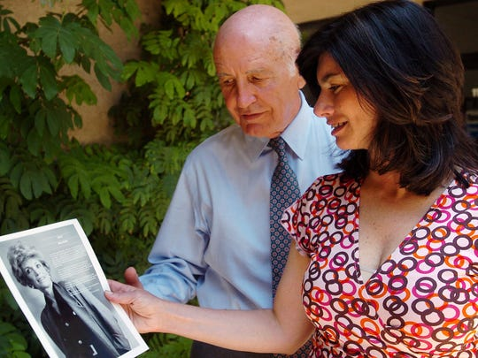 Marshall Gelfand and his daughter Elizabeth Gelfand Stearns, look at a photo of the late Judy Gelfand.  -06/08/04 Carey Wagner The Desert SunMarshall Gelfand (cq) and his daughter Elizabeth Gelfand Stearns (cq) look at a picture of Marshall's wife, Judy (cq), Elizabeth's mother, who was diagnosed with Alzheimer's in 1995 and does not recognize her family today. The two gather for a meeting at the Alzheimer's Association in Palm Desert.