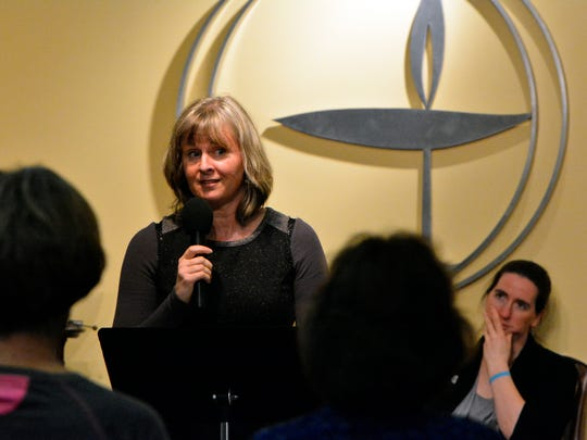 Erika Juran, director of communications and administration, reads a message from MoveOn.org during a service for about two dozen people at the Unitarian Universalist Church of York in the wake of a tumultuous election, Wednesday, Nov. 9, 2016. John A. Pavoncello photo