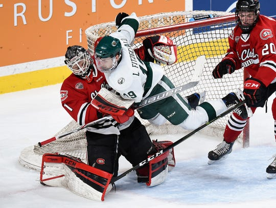 Bemidji's Leo Fitzgerald lands on St. Cloud State goalie