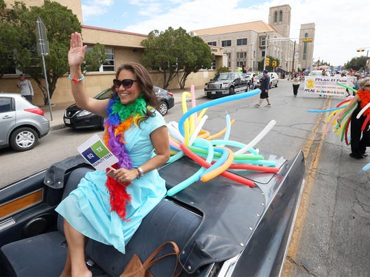 El Paso County Judge Veronica Escobar rides in a convertible Saturday.