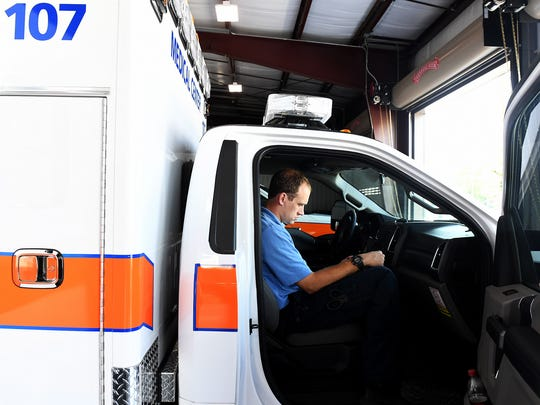 West Tennessee Healthcare Medical Center EMS paramedic Taylor Teel logs information into his laptop after returning to the EMS bay, Thursday, August 10.