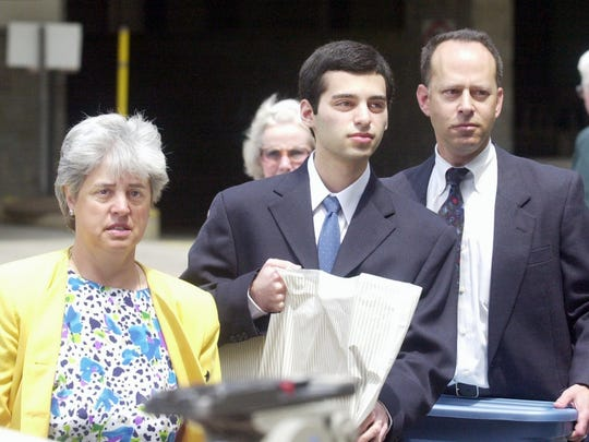 "Zachary Witman, 19, is flanked by his parents Amelia ""Sue"" and Ronald while arriving at the York County Courthouse Wednesday for the start of his trial.  Zachary is charged with the 1998 killing of his younger brother Gregory."