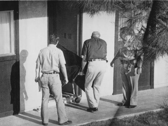 Authorities remove the body of actor Bob Crane from a Scottsdale apartment where he was discovered beaten to death June 29, 1978.