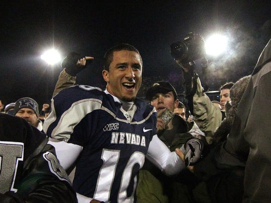 Wolf Pack quarterback Colin Kaepernick celebrates with fans after Nevada's win over Boise State in 2010.