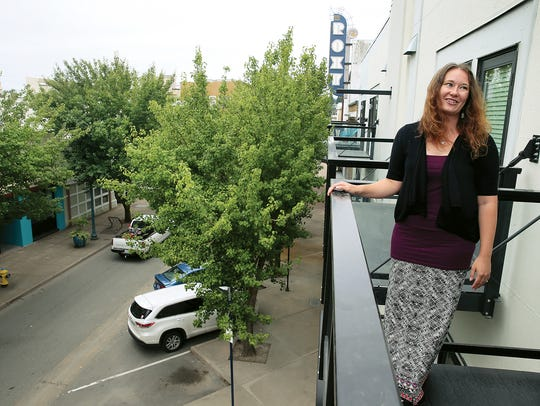 Marianne Weber, the property manager for the Sound West Group, is on a balcony of one of the B Flats apartments on Fourth Street in Bremerton.