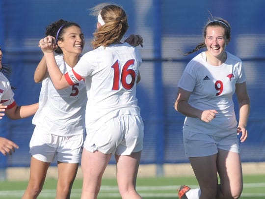 Cooper's Maddie Abor, left, celebrates with Caylee