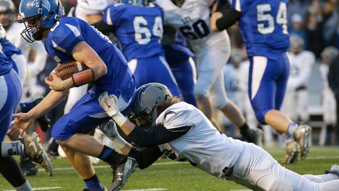 Amherst quarterback Marcus Glodowski sheds the tackle of Lake Country Lutheran's Tyler Johnston on his way to a Division 5 title game record of 269 yards rushing.