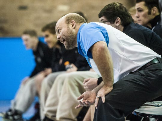 UGF's head coach Caleb Schaeffer yells instructions to Luke Schlosser during the wrestling match against Northwest College in the McLaughlin Center on Friday.