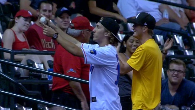 A fan caught two foul balls in one at-bat.