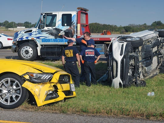 Emergency crews work the scene of a two-vehicle collision
