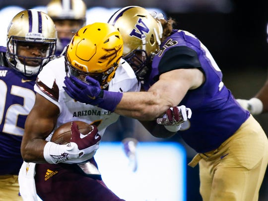Washington defensive lineman Shane Bowman (96) tackles Arizona State receiver N'Keal Harry during a 2016 game at Husky Stadium. Bowman and his brother, Ryan, both starred at Bellevue High before coming to Washington, though Ryan took a one-year detour to Florida.