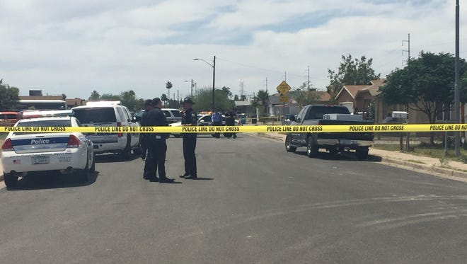 Phoenix police officers responded to a shooting near 15th Avenue and Hadley Street on May 21, 2015.
