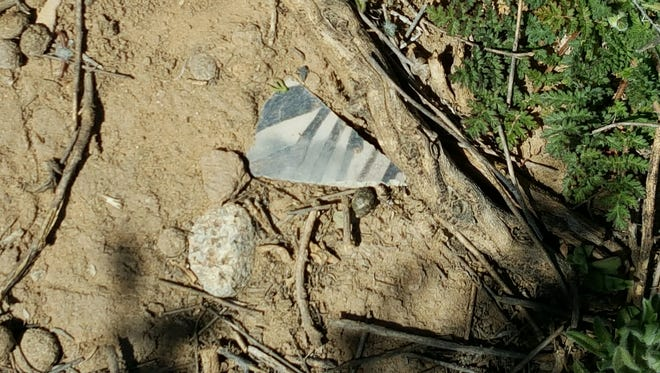 Pottery sherds are seen at the Holmes Group site in this undated courtesy image.
