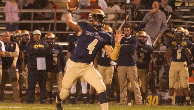 Holy Spirit's QB, Josh Zamot, 4,throws the ball against Delsea during the first quarter of the game at Holy Spirit home field.