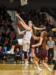 Waukee's Anna Brown (20) goes up for a shot as Dowling's Caitlin Clark (11) defends during a basketball game between the Waukee Warriors and the Dowling Maroons on Tuesday, Jan. 30, 2018 At Waukee High School.