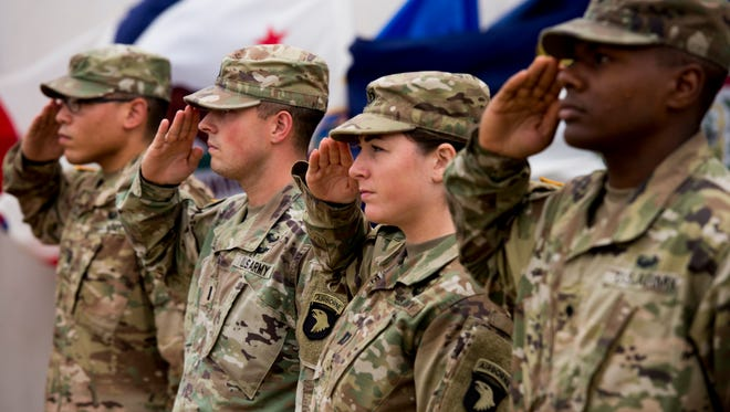 Soldiers salute during the boot ceremony honoring 7,300 fallen soldiers on September 11, 2017.