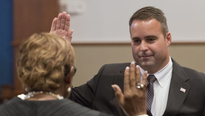 In this file photo, Escambia County Judge Joyce H. Williams, left, administers the oath of office to new Escambia County Commissioner Doug Underhill.