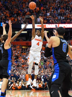 Syracuse Orange guard John Gillon (4) takes the game winning shot in the final moments of the game against the Duke Blue Devils at the Carrier Dome. The Orange won 78-75.