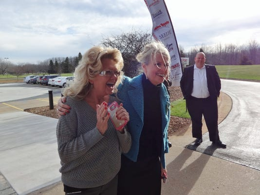 635860439822492551-Susan-Schoder-on-left-hears-she-has-won-the-UW-Sweepstakes.jpg