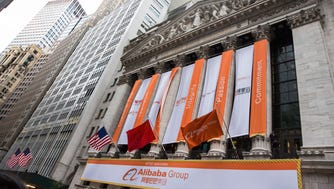 NEW YORK, NY - SEPTEMBER 19:  Alibaba Group signage is posted outside  the New York Stock Exchange prior to the company's initial price offering (IPO) on September 19, 2014 in New York City. The New York Times reported yesterday that Alibaba had raised $21.8 Billion in their initial public offering so far.  (Photo by Andrew Burton/Getty Images) ORG XMIT: 513259631 ORIG FILE ID: 455704682