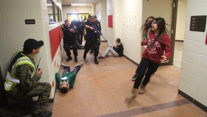 Though only a test, this 2014 'live shooter' drill at the former Latson Elementary School in Genoa Township is an example of the kind of training local have undertaken to prepare for any type of school threat.