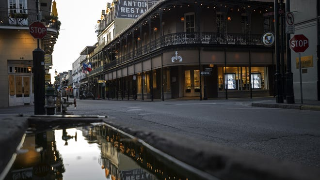 Antoine's Restaurant can be seen on the empty corner of Royal and St. Louis streets in the French Quarter during the coronavirus pandemic shutdown in New Orleans.