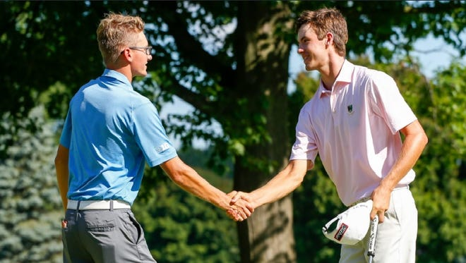 Alex Smalley (right) congratulates Dylan Meyer on his 4-and-3 victory in the Round of 32 on Thursday morning at Oakland Hills Country Club. Smalley was the stroke-play medalist and Meyer is coming off a win in the Western Amateur on Aug. 6.