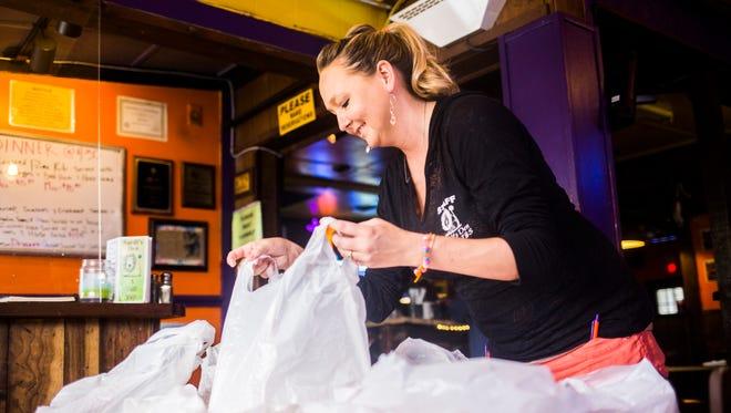 Manager Kat Smith bags on of 150 meals for Clemson's football team at Sardi's Den on Thursday, September 1, 2016 in Clemson.