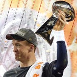 Broncos quarterback Peyton Manning celebrates with the Vince Lombardi Trophy after beating the Panthers in Super Bowl 50.