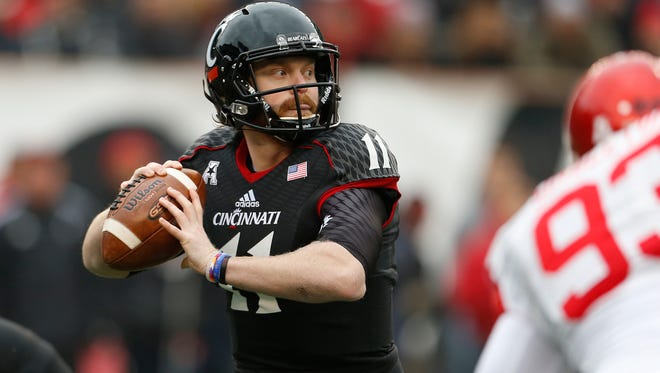 Bearcats quarterback Gunner Kiel throws against Houston on Dec. 6.