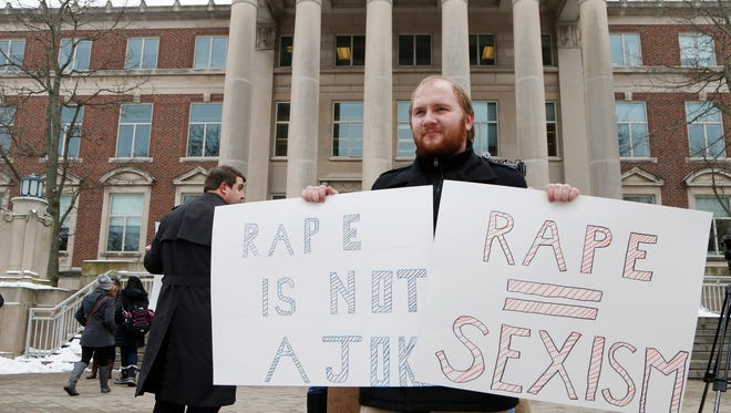 Colten Austerman takes part in a rally agains sexual assault Monday, February 15, 2016, in front of Hovde Hall on the campus of Purdue University.