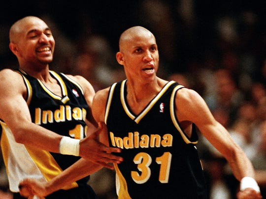 Indiana Pacers guards Reggie Miller (31) and Mark Jackson taunt New York film director and avid Knicks fan Spike Lee, after Miller scored eight points in the last quarter of the game against the Knicks, at New York's Madison Square Garden, May 7, 1995. Miller contributed 31 points in the Indiana Pacers come-from-behind  107-105 victory in the semifinal of the Eastern Conference.
