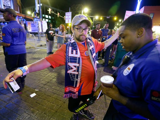 June 12, 2016-  1:08 AM - Brandon Bazer, of Marseilles France, gets wanded during his visit to Beale Street on the first night of Beale Street Bucks.   (Nikki Boertman/The Commercial Appeal)