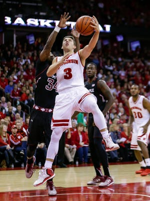Wisconsin's Zak Showalter (3) shoots past Temple's Devin Coleman (34) during the second half of an NCAA college basketball game Saturday in Madison. Wisconsin won 76-60.