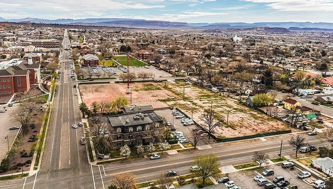 An aerial view shows where most of a city block has been cleared to make room for the new mixed-use Joule Plaza development in downtown St. George.