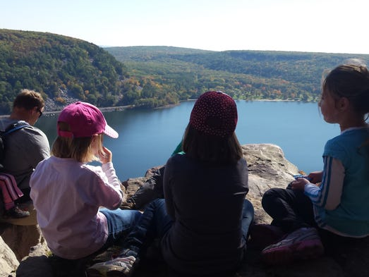 A group rests for lunch on a bluff overlooking Devil's