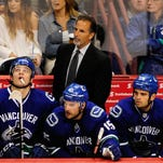 John Tortorell coaches the Vancouver Canucks during a game against the Phoenix Coyotes in 2013.