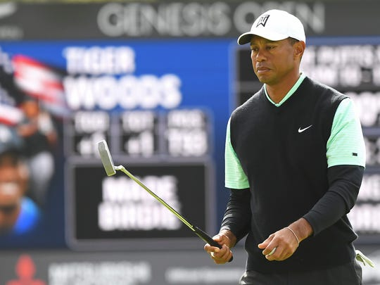 Tiger Woods reacts to a birdie on the 8th hole during the continuation of the first round of the Genesis Open.
