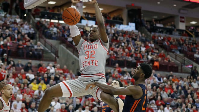 """Ohio State forward E.J. Liddell, dunking against Illinois in March, is listed as one of 10 """"breakout players"""" by CBS Sports' Jon Rothstein."""
