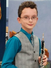Peyton Hand is an excellent oboist and plays in the Murray Middle School Band.