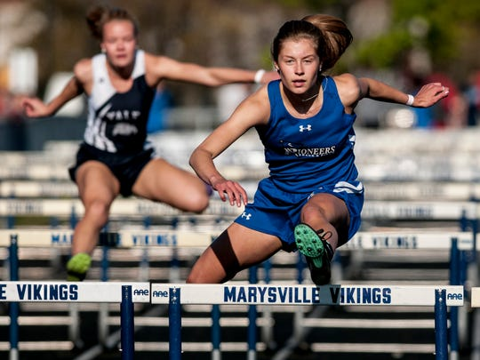 Croswell-Lexington's Calli Townsend competes in the hurdles during the Marysville Invitational track meet Friday, May 12, 2017 at Marysville High School.